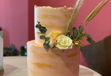 Pink and gold themed cake by sugarbox patisserie
