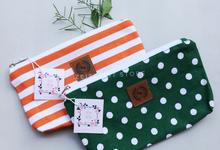 Reza & Reiny Orange & Green pouch favors  by ZEITGEIST