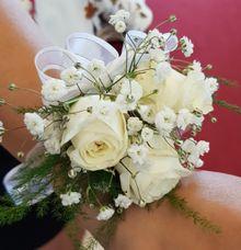 Wrist Corsage & Glamorous Floral Arch by Dorcas Floral