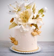 Elegant sugar lilies and magnolias cake by Haute Cakes Singapore