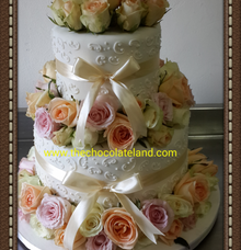 wedding cake with flowers by The Chocolate Land