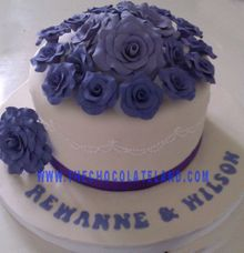 1 tier wedding cake with purple flowers by The Chocolate Land