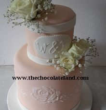 2 tiers wedding cake with salem theme colour by The Chocolate Land