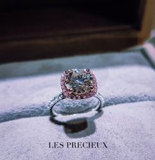 ROUND DIAMOND WITH PINK SAPPHIRE HALO ENGAGEMENT RING by LES PRECIEUX