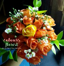 Orange Hand bouquet by Colours Florist