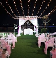 Fairylights Drapes Across Our Customize Flora Arch by Victoria Wedding Collection