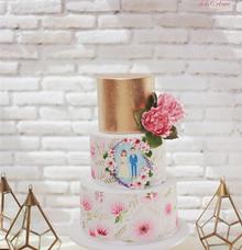 Handpainted watercolor floral wedding cake by Creme de la Creme Bali
