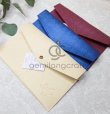 Prada envelope for Adit and Clara by Gemilang Craft