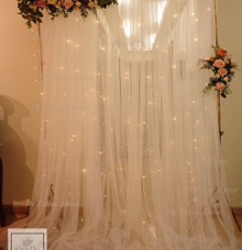 Floral with fairy light backdrop by Patson Decor