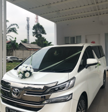 Elegant in white flowers by Panen Rental Car